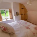 Double bedroom of the Dartmoor Holiday Home in Lustleigh