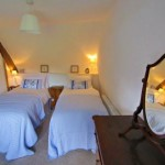 Twin bedroom of Three Pound Cottage, Dartmoor, Devon