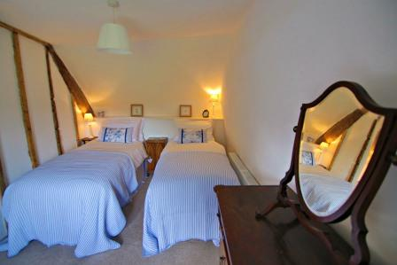 Twin bedroom of Three Pound Cottage, Dartmoor, Devon