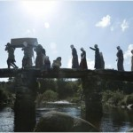 Devon Folklore procession over a Dartmoor Clapper Bridge