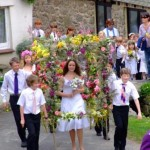 The May Queen procession passing directly in front of the lustleigh self catering holiday cottage