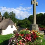 Henry Tudor Monument on Lustleigh's village green just in front or our rose covered Dartmoor self catering holiday cottage