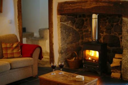 The cosy yet spacious lounge of the Thatched Dartmoor Holiday Cottage in Lustleigh