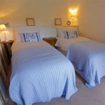 Spacious Twin Bedroom of Three Pound Cottage the Thatched Dartmoor Holiday Self Catering Accommodation