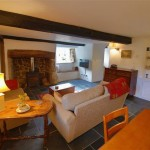 Comfortable Lounge of Three Pound Cottage, a thatched holiday home in Lustleigh on Dartmoor