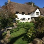 Wreyland Manor, an impressive thatched Devon long house near our self catering dartmoor holiday cottage