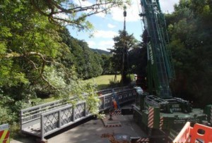 Bridge being lifted into place for the Wray Valley Trail joining Bovey Tracey and Moretonhampstead through Lustleigh close to Three Pound Cottage the self catering dartmoor holiday accommodation