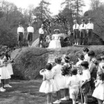 Lustleigh's May Queen being crowned in the village orchard