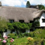 The wonderfully impressive thatched Devon longhouse known as Wreyland Manor is a short stroll from our Dartmoor holiday cottage