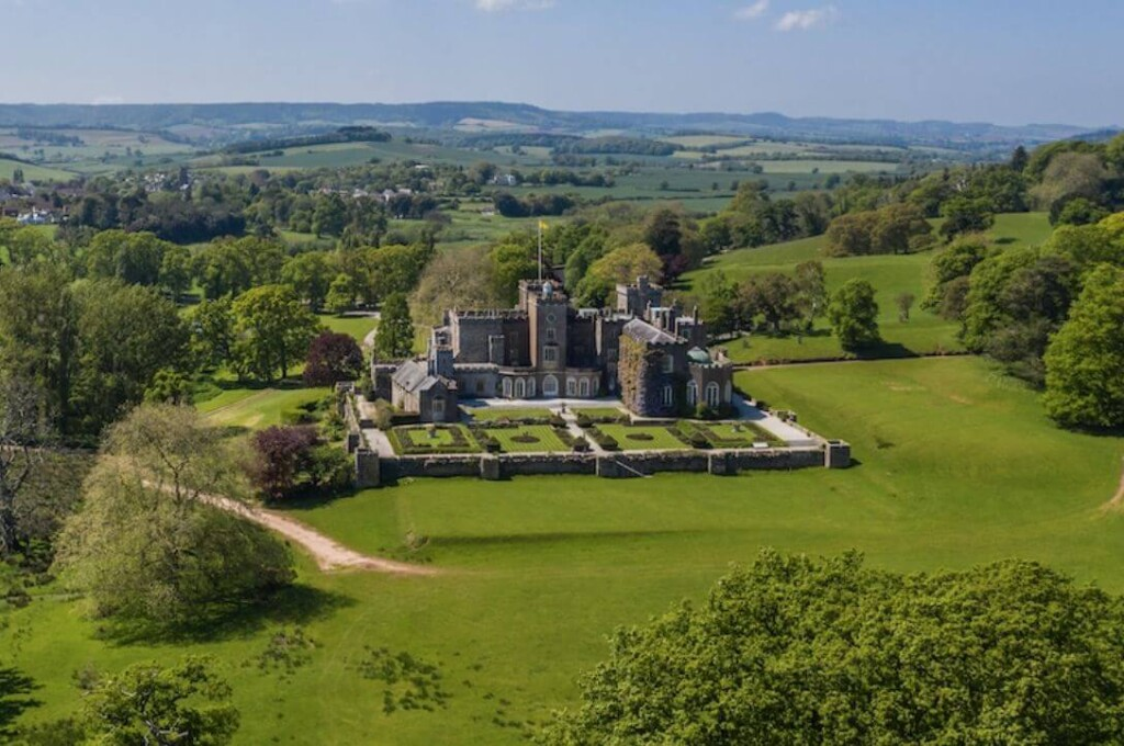 Powderham Castle in its picturesque setting with views of Dartmoor and the Devon countryside in the background
